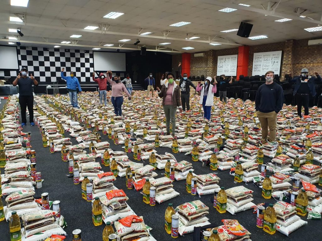 packing food for those in need in Johannesburg. Outreach programme.
